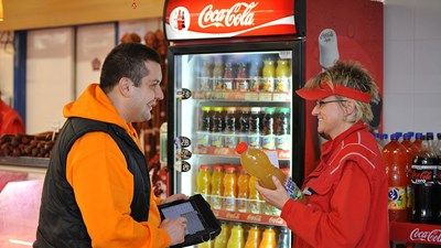 #CocaColaHBC representative with a customer
