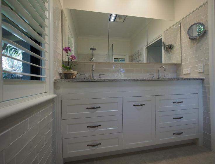 Custom made vanity and mirror cabinet by Anglewood Bespoke Furnishings.