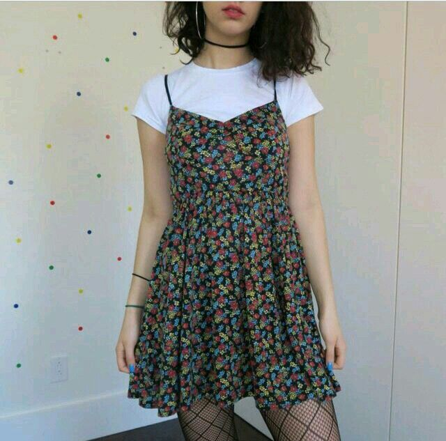 I like how this is mixed with a punk rock vibe and a girly summer dress. Cute
