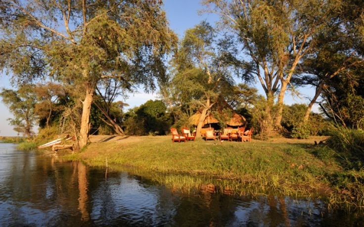 ULTIMATE AFRICA  FEATURE DESTINATION  TSIKA ISLAND BUSH CAMP  Set in the middle of the Zambezi River, Tsika Island is approximately 30 – 35 km upstream from Chongwe between Mana Pools National Park in Zimbabwe and the village of Mugurameno in Zambia.