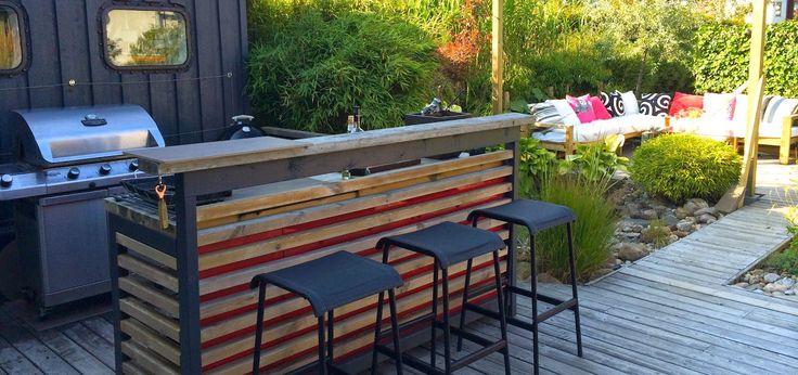 Colorful, lush contemporary garden. Outdoor kitchen. Patio. Design: Eira Fogelberg