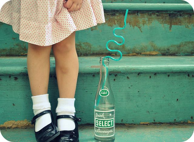 vintage style dress, mary janes, bobby socks, distressed aqua stairs, glass bottle soda pop, fun straw.  What's not to love?