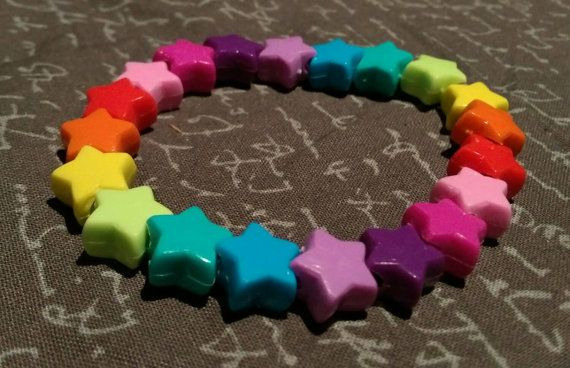 Check out this item in my Etsy shop https://www.etsy.com/listing/263320657/kandi-rainbow-star-beads-raver-bracelet
