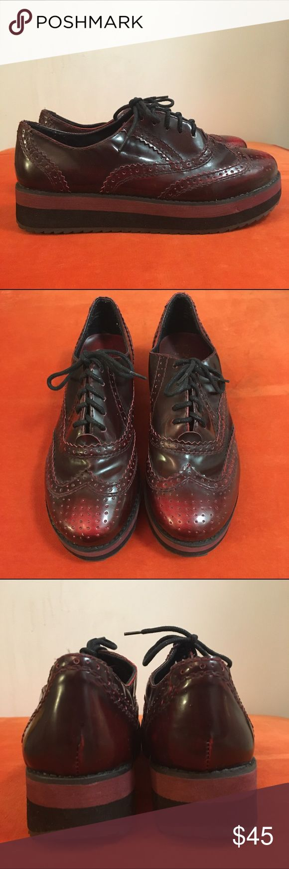 Oxblood Red patent leather oxford creepers i am selling a never been worn paid of super stylish oxfords!  color is oxblood red with some beautiful detailed stitching. laces are black and the sole is almost a sturdy foam-like sole. feels like you are walking on absolute comfort. the sole itself it about an inch tall (gives it the creeper style aspect). check out the pics! Big Buddha Shoes Flats & Loafers
