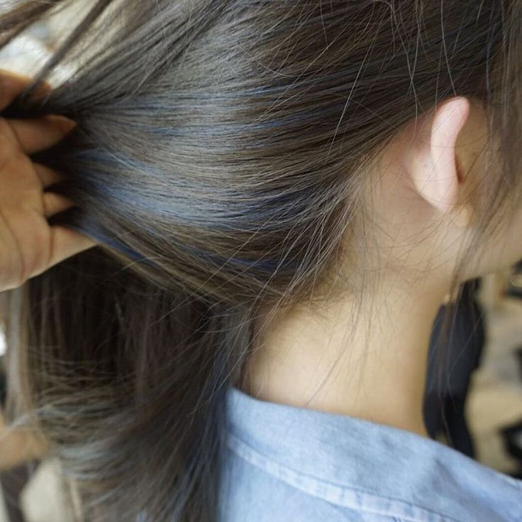 Peekaboo! Subtle strands of sapphire highlights that'll add a pop of colour to a natural dark hair colour base.