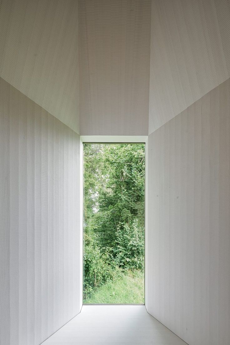 "The view straight ahead through the white apse leads directly into the nature,"" said the architects. ""Whoever enters the chapel leaves the solid ground and proceeds a reflective journey."""