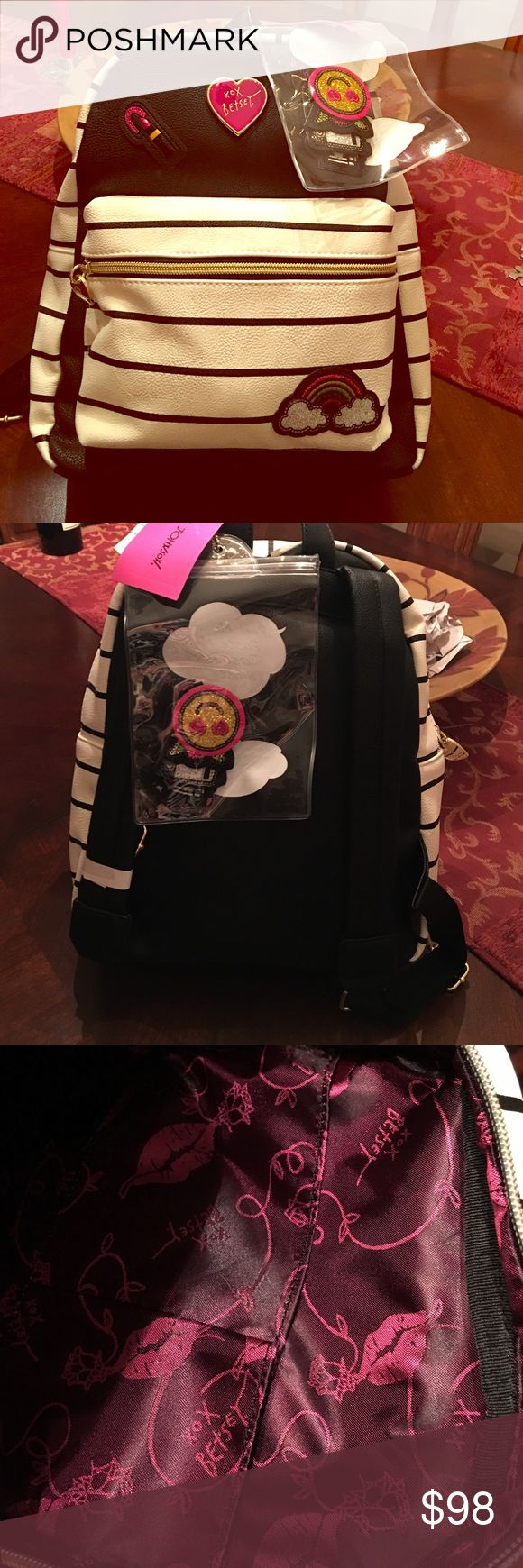 🆕Betsey Johnson Striped emoji 🌈💄Backpack RARE! 🆕 RARE! Adorable Betsey Johnson backpack. White and black with black stripes, big pink Betsey heart emblem, rainbow & lipstick patches. Zippered front pocket, zip top, purple Betsey logo lip print lining & gold heart zippers. Includes pouch with permanent adhesive patches (smiley face, rose, Betsey, and what looks like a camera- didn't want to open pouch. Brand new with tags! $108 orig. Open to fair offers! This is a collectible for sure…