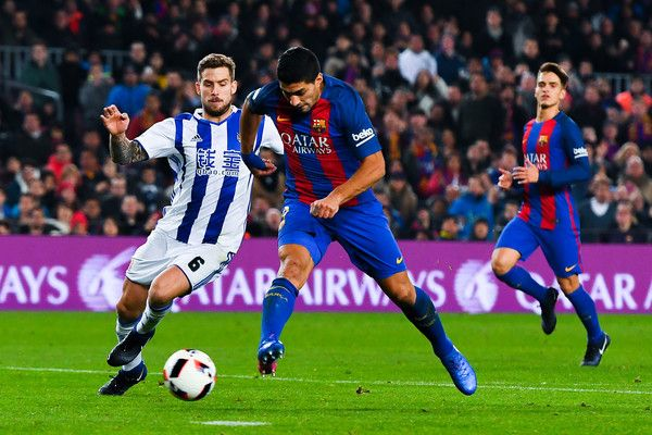Luis Suarez of FC Barcelona scores his team's third goal past Inigo Martinez of Real Sociedad de Futbol during the Copa del Rey quarter-final second leg match between FC Barcelona and Real Sociedad at Camp Nou on January 26, 2017 in Barcelona, Catalonia.