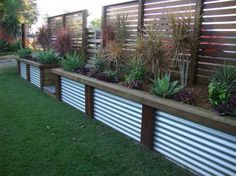 corrugated aluminum fence with redwood frame | Fence Designs by scenic scapes landscaping. The taller fence a little ...