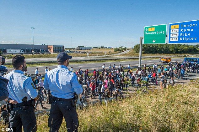 The migrants forced the closure of the main E45 motorway near Kliplev having arrived from ...