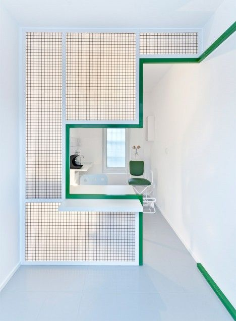 A stepped cut-out in the mesh partition forms a customer service window in this…