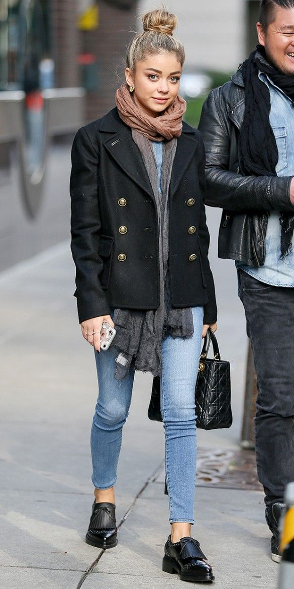 Sarah Hyland keeps warm in a double-breasted jacket, scarf and skinny jeans.
