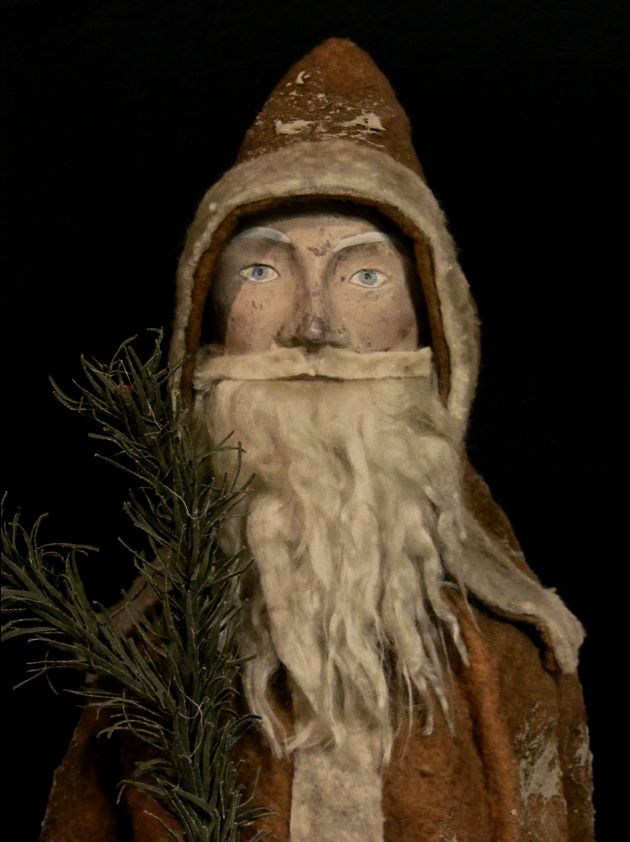 sold      Replica of a very old primitive Santa.           About 19.5 inches tall