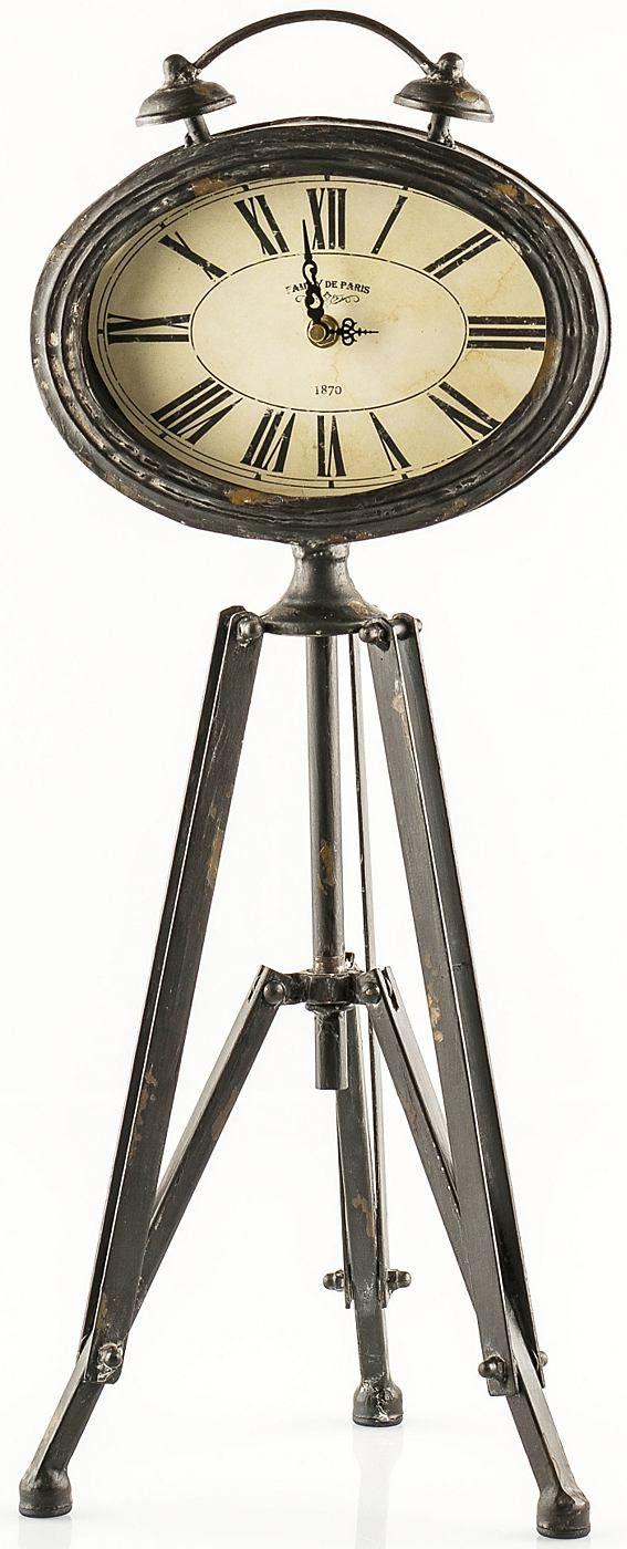 Die Zeit immer im Blick… Mit dieser wunderschönen Standuhr haben die eine stilvolle Wohndekoration gefunden. Die Uhr ist ein echter Hingucker und steht auf einem Gestell aus Holz. Die Standuhr im antiken Look hat die Maße (B/T/H): 26/26/60 cm.   Artikeldetails:  Stilvolle Uhr, Auf einem Gestell, Mit römischen Zahlen,  Maße:  Maße (B/T/H): 26/26/60 cm,  Material/Qualität:  Holz,  Wissenswertes: ...