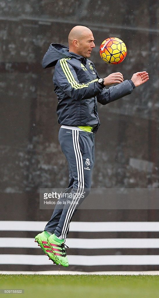 Head coach Zinedine Zidane of Real Madrid controls the ball during a training session at Valdebebas training ground on February 12, 2016 in Madrid, Spain.