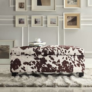 @Overstock.com - Kayla Cow Hide Fabric Storage Bench Ottoman - Expand your seating and relaxation options with this big storage bench ottoman. The padded lid will support your feet or seat comfortably, but it also hides a secret compartment to hold nearly anything. The cowhide fabric brings a touch of fun.  http://www.overstock.com/Home-Garden/Kayla-Cow-Hide-Fabric-Storage-Bench-Ottoman/8119600/product.html?CID=214117 $207.99