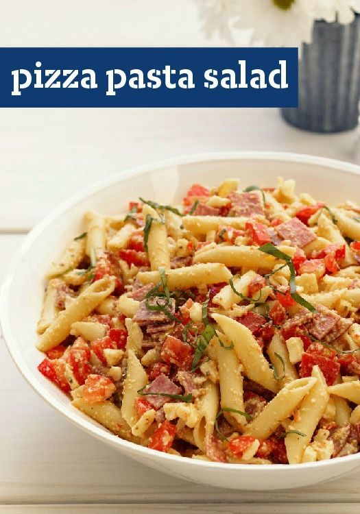 """Pizza Pasta Salad -- This pasta salad recipe has all the flavors you love in one unbelievably easy-to-make dish. How easy? """"Combine ingredients."""" (That easy.)"""