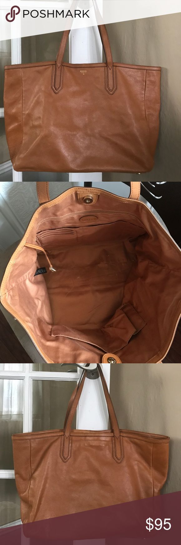 Fossil Tote Tons of storage! Slight discoloration on bottom corner of bag. Comes with protective dust bag. Smoke free home! Fossil Bags Totes