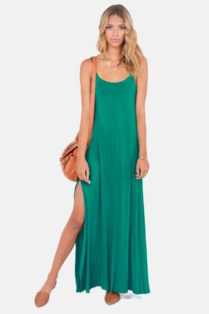 Check it out from Lulus.com! Match the Such Great Heights Teal Maxi Dress with some wedges and a statement necklace, and you've got the perfect look for a rooftop revelry! A plunging low-cut back with sexy strap detail is only outdone by two towering side slits to really show off those legs. Spaghetti straps with scoop neck support teal jersey knit that flows to a maxi-length hem. Front of bodice is lined. Model is wearing a size small. 95�0Rayon, 5�0Spandex. Hand Wash Cold. Made with Love…