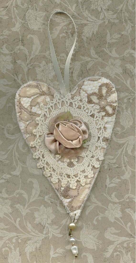 Fabric art heart in off white and beige laces with antique crochet piece via Etsy