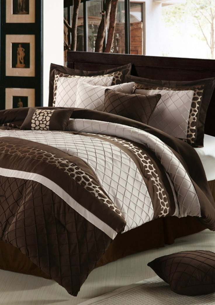 chocolate cheetah bed spread (like the use of various textures and fabrics...also like them sewn on the horizontal line...will have to try this the next time I redo our bedroom)
