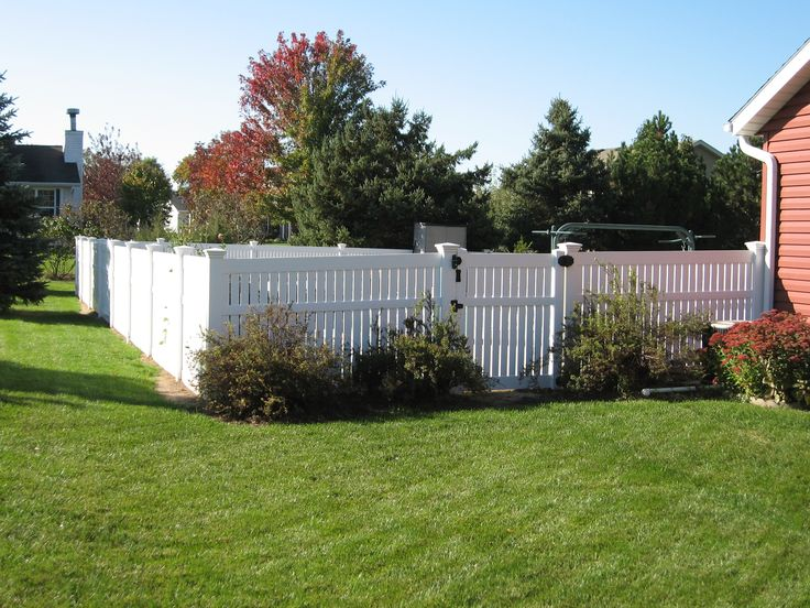 Vinyl fencing. I like this style because it's only semi-private.