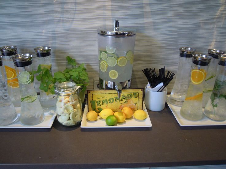 An old-fashioned lemonade sign adds character to a citrus-themed refreshment…