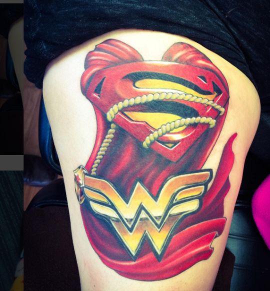 #superman #wonderwoman #tattoo  via  girlonfire84  done by  Zen Art ink studios