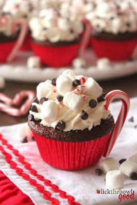 Hot Cocoa Cupcakes Recipe -use regular chocolate cake recipe but use cooled prepared cocoa instead of water and a little more vegetable oil. Decorating with marshmallows and a peppermint stick: so cute!