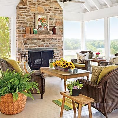 The porch's vaulted ceiling rises to 15 feet. The rustic accents displayed on this porch give a nod to the surroundings. | SouthernLiving.com