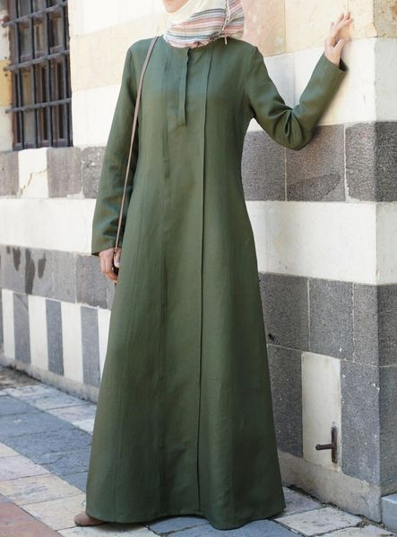 The clean lines and streamlined silhouette of the Minhah Dress are just what you need this season. Designed with 2 cleverly placed single pleats down the front, this dress was made to flatter. And less is more with simple accessories and a breezy wrap hijab to top it off. Note: This product requires 3 working days processing time before it is shipped.