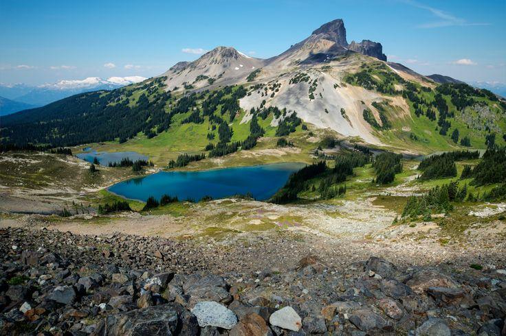 The peak is called black tusk and is above some beautiful blue lakes in Garibaldi park in British Columbia.  Location: Garibaldi Park, Whistler, British Columbia, Canada