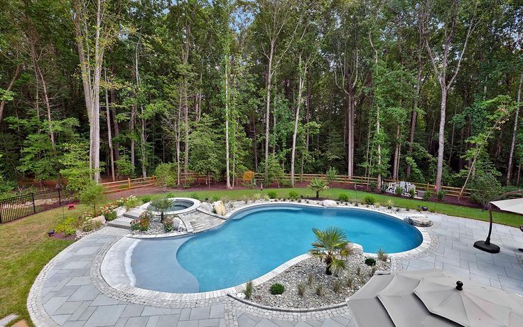 A gorgeous zero-entry pool completed this outdoor living space by JamesRiverConstruction.com