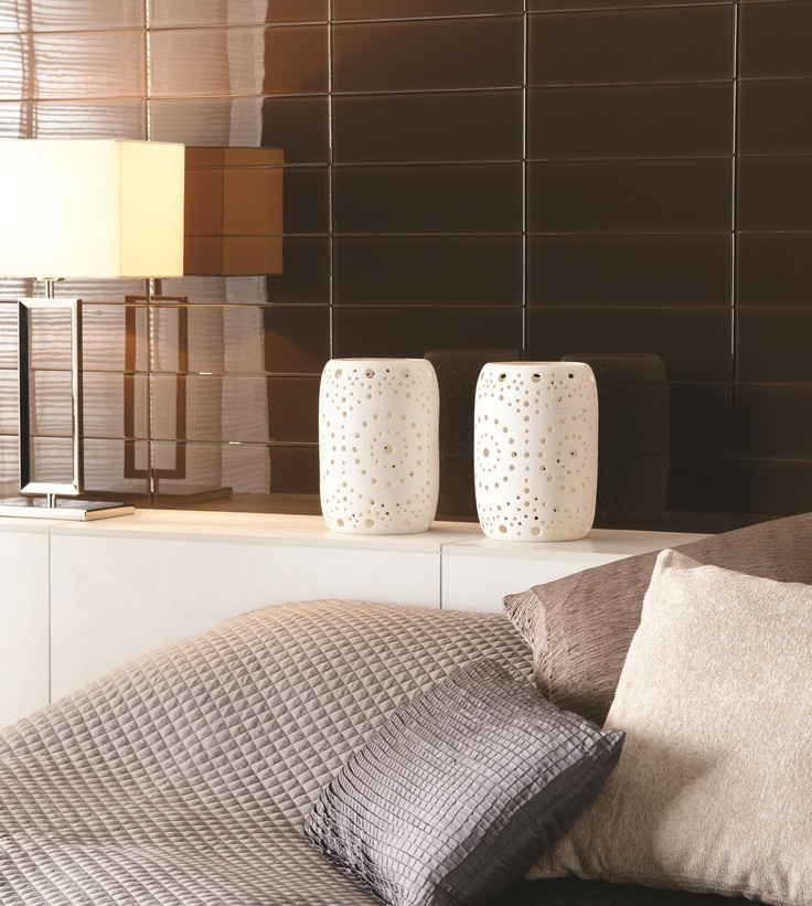 These deep brown Chenab tiles are neutral and calming in the bedroom.