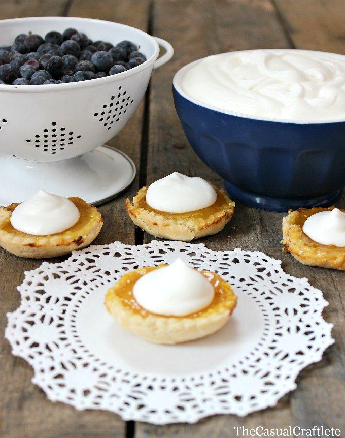 Mini Lemon Tarts with fresh blueberries and whipped cream via @Rebecca - Simple as That Blog #tart #dessert