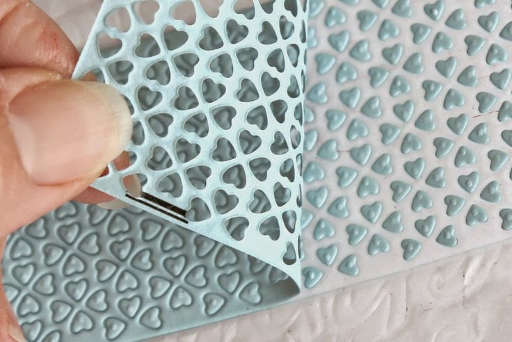 Dryer sheets to the rescue! Best tip ever for releasing paper from intricate dies after cutting.  And the paper stays in place exactly like you cut it.  Works best with a metal precision plate as your base though.