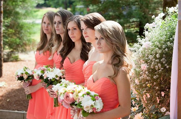Coral dresses are acned with white, pink and apple green bouquets