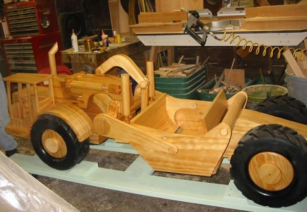 A scraper sits in Chuck's shop with some of his woodworking equipment in the background….by Chuck Hoggarth..
