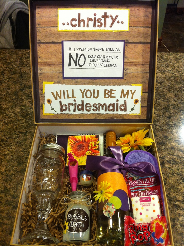 Bridesmaid gift boxes... Wine bottle, wine glass, wine stopper, wine glass marker, lip balm, coaster, color swatch of chosen color, face mask, eye mask, Kleenex, flower, ring pop and a jar of bubble bath.