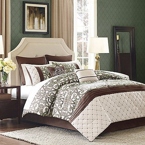 Create a high-end fashion bedroom with the Monica 8-piece comforter set. This set features a one-of-a-kind comforter pieced with an ornate iron gate scroll motif, pleated band, and soft quilted lattice in a stylish palette of crème, chocolate, and sage.