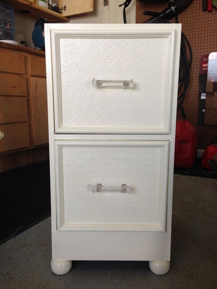 Metal Filing Cabinet Makeover by adding picture frame molding, feet, & new handles