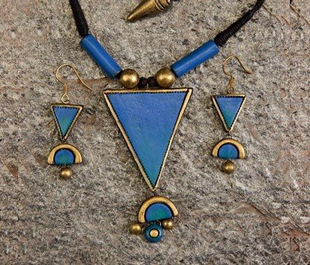 Triangle shaped handmade terracotta jewelry set painted on bright blue acrylic https://www.facebook.com/KavisTerracottajewellery