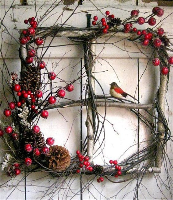 Pretty rustic winter wreath...Collect branches. Cut nail together to make a window. Embellish with grapevines, berries, pinecones birds.: