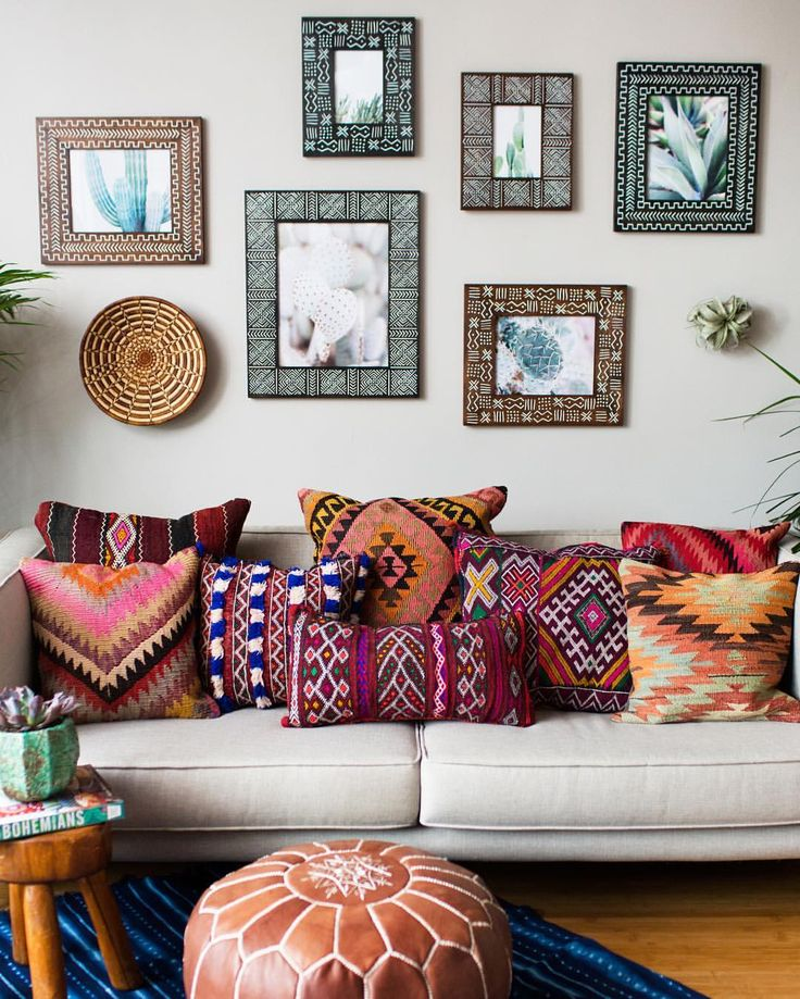 Lots Of Pillows And Mirrors With A Pouf For Boho Sitting Space