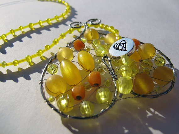 Unique handmade suncatcher mobiles - Small Yellow Hearts by Hero and Leander for a price of $12.00