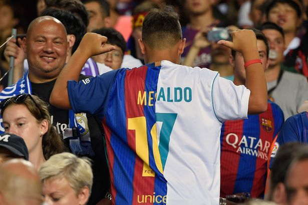 73. A fan at the Spanish Super Cup El Clasico clash reveals possibly the worst football shirt of all-time