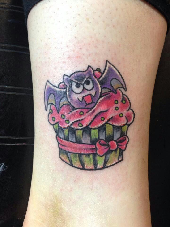 Ribbon Wrapped Pink Cupcake with Cute Bat Topper Tattoo ...