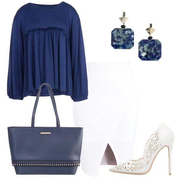 Il total look è composto da una blusa morbida in jersey blu scuro ed una gonna bianca a portafoglio. L'outfit si completa con una una borsa a mano con decorazione di piccole frange con borchie, un meraviglioso paio di décolleté in pelle traforata e degli orecchini in ottone vetro e resina.