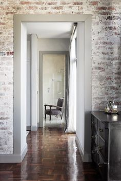 Don't love parquet, but these walls and trim are gorgeous and it looks good with the dark floors.