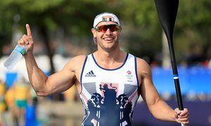 Great Britain's Liam Heath celebrates winning gold in the 200m kayak single…